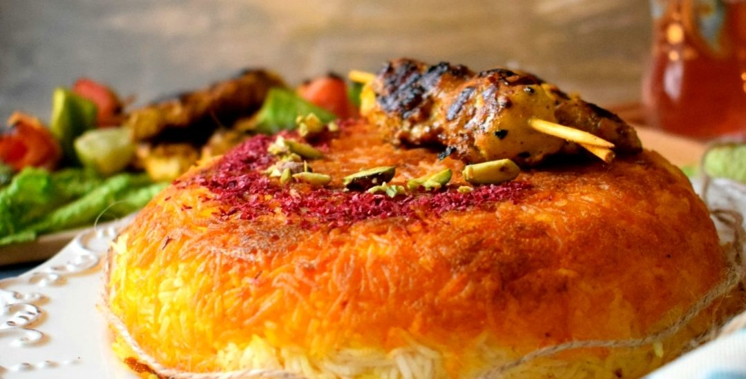 Tachin ( Saffron flavored Rice Cake) with Joojeh Kebab