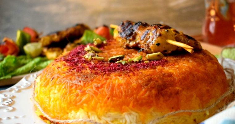 Tachin ( Saffron flavored Rice Cake) with Joojeh Kebab